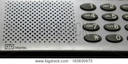 button landline phone with answering machine gray