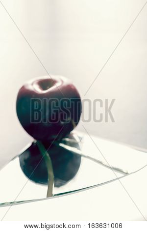 Defocused Red Apple On Broken Mirror