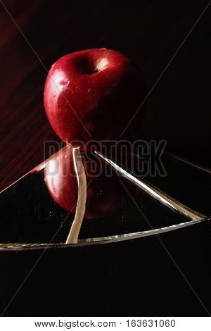 Red Apple On Broken Mirror