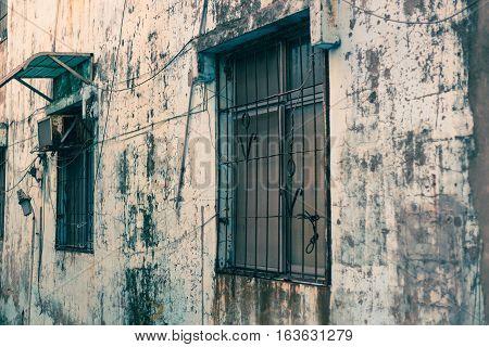 Windows Outside Old House