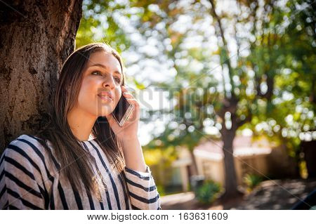 Female On A Smart Phone Outside