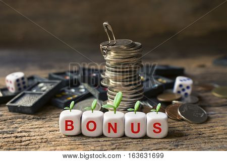 strack of coins and wording bonus concept idea for business