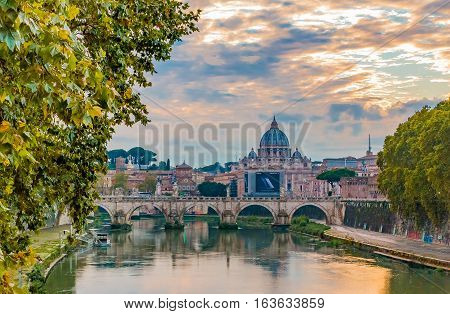 View Of St. Peter's Basilica Over Tiber At Sunset