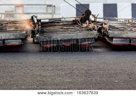 Serface Heater Machine Working On Asphalt Road