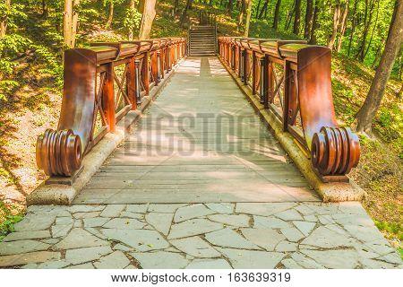 Beautiful bridge over the ravine. This photo was taken in a park, near Kiev.