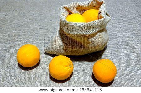 Authentic oranges sac of Valencia Spain. Authentic potatoes sac of Galicia Spain. On jute canvas