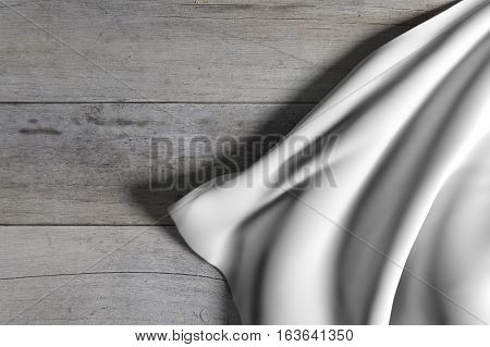 Silken Cloth Falling Across Wooden Floor
