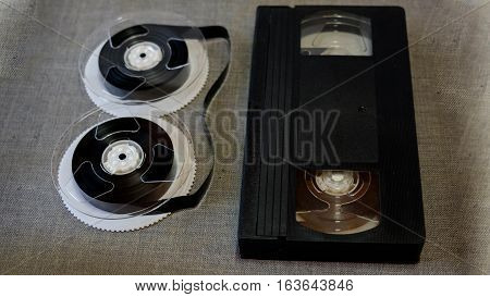 The components of the VHS tapes on a gray background