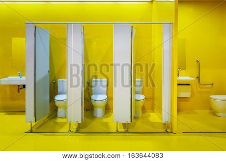 A set of vivid yellow public restroom