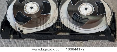 disassembled VHS cassette components in the background