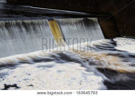 Weir below Avon Dam with water flowing down. Dartmoor Devon England United Kingdom.