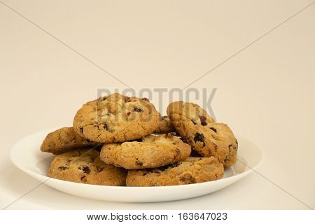 Shortbread cookies with raisins on a white plate