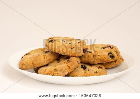Cookies with raisins on a white plate
