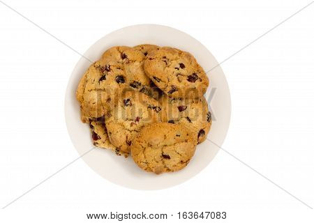 Cookies with raisins on a white plate. Top view