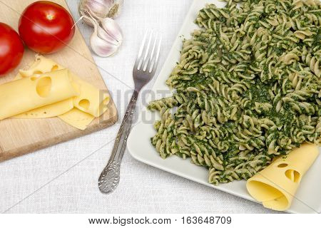 tatsy pasta with spinach for dinner, copy space