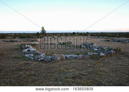 Ancient house foundations in a great plain grassland area at the swedish island Oland