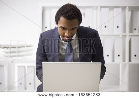 African Businessman Working With Tongue Out