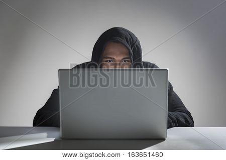 African American Hacker In A Hoodie