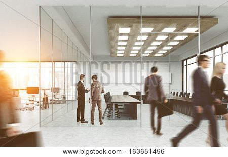 Men and women in suits walking in a glass office. Bright sunlight. Concept of office life. 3d rendering. Toned image. Mock up