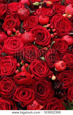 Red ranunculus berries and roses in a group