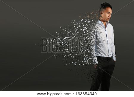 Man with pixel dispersion effect. Disintegration of body