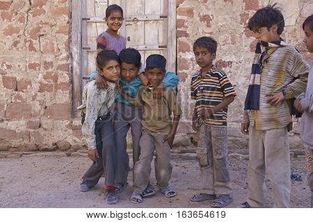 NAGAUR, RAJASTHAN, INDIA - FEBRUARY 14, 2008: Playful group of children in the backstreets of Nagaur in India.