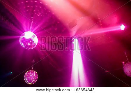 Blurred colorful laser lights with vintage disco ball - Defocused image -Concept of nightlife with musicdrink and entertainment - Original color bokeh - Warm filter