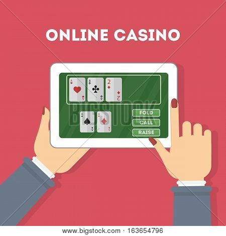 Online casino in the tablet. Hands holding device with gambling game. Gaming addiction.