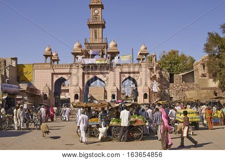 NAGAUR, RAJASTHAN, INDIA - FEBRUARY 16, 2008: Busy market outside main gateway to the historic fort in Nagaur, India.