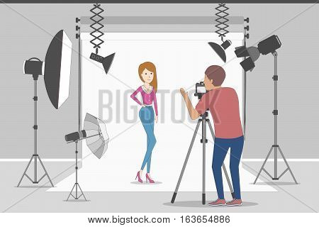Model in photo studio. White background with lights and cameras. Photographer making photos. Fashion clothes.