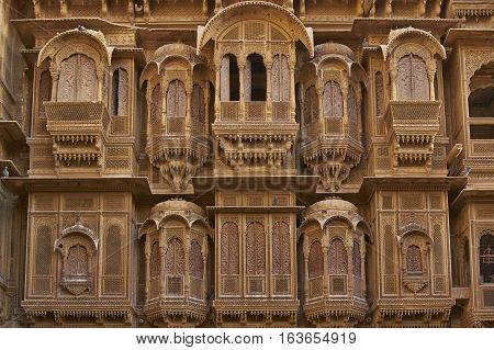 JAISALMER, RAJASTHAN, INDIA - FEBRUARY 18, 2008: Detail of ornate window screens adorning the Patwon Haveli, a historoc merchants house, in the old town of Jaisalmer in Rajasthan, India.
