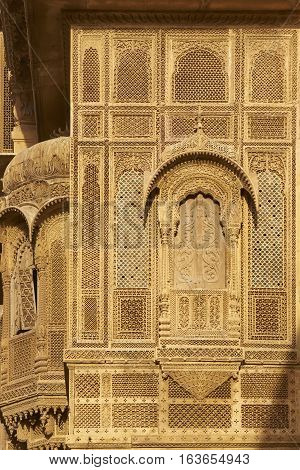 JAISALMER, RAJASTHAN, INDIA - FEBRUARY 18, 2008: Delicate carved stone walls and window surrounds of a wealthy merchants Haveli in the historic quarter of Jaisalmer in Rajasthan India