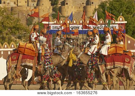 JAISALMER, INDIA - FEBRUARY 20, 2008: Camels and riders of the Indian Border Security Force perform in front of the Fort on February 20, 2008 during the Desert Festival in Jaisalmer, Rajasthan, India