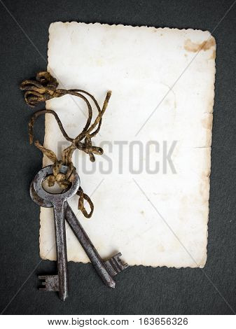 Rusty key and empty photography as a memory metaphor