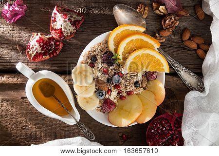 Healthy Breakfast. Muesli With Orange Fruit, Apple, Pomegranate, Nuts, Banana And Honey