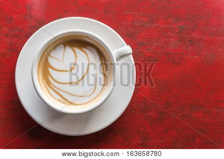 Top View Hot Latte Coffee In White Cup On Wooden Table