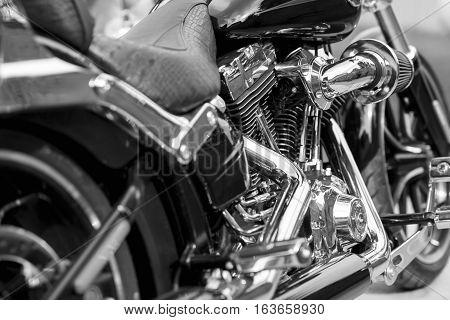 Shiny chrome motorcycle engine block. Black and white.