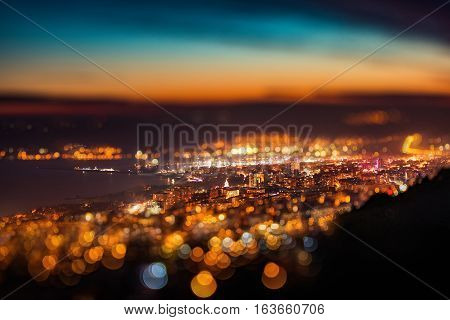 Tilt Shift Blur Effect. Night Aerial View Panorama Of Varna Town