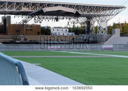 Empty Stage: Preparation on a Green Meadow Before A Concert