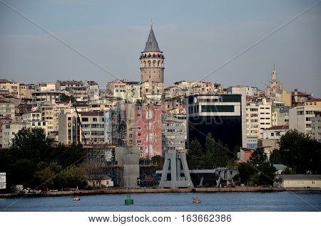 Galata or Karaköy quarter of Istanbul on the Bosphorus. Skyline on Asian side of the Turkey's capital city, with the Galata Tower and construction work