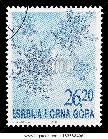 SERBIA AND MONTENEGRO - CIRCA 2003 : Cancelled postage stamp printed by Serbia and Montenegro, that shows Snow flakes.