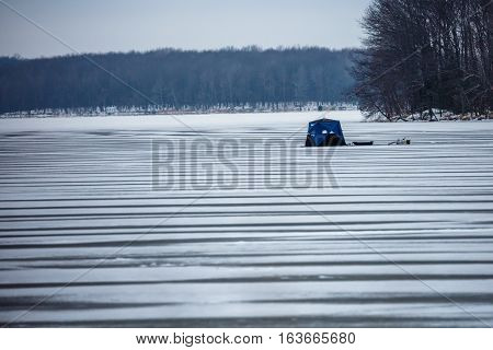 Ice fishing on a lake in Wisconsin.
