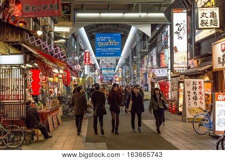 Osaka, Japan - December 09, 2014: People in the covered shopping arcade in Dotonbori district