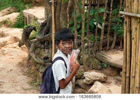 POPOTOTAN ISLAND PHILIPPINES - JANUARY 162012: Boy goes to Maglalambay elementary school
