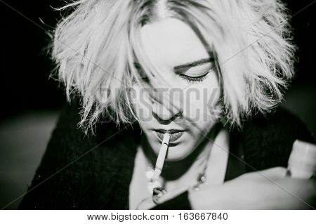 Portrait Of A Girl With A Cigarette. Young Beautiful Girl Hipster Smoking A Cigarette In The Street