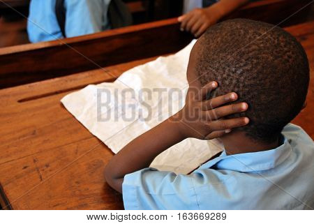 This kid does not want to listen in school. Mozambique, Africa