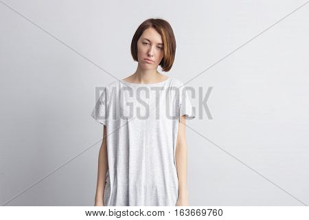 Girl suffers from insomnia it is to a large nightgown with half-closed eyes