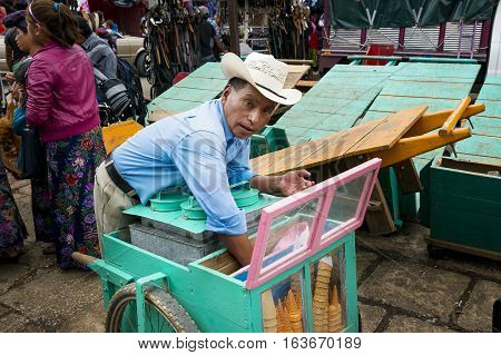 San Cristobal de Las Casas Mexico - May 10 2014: A man selling Ice Creams in a street market in the city of San Cristobal de Las Casas in the Chiapas region Mexico.