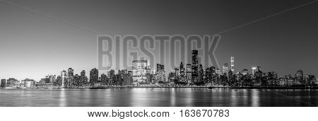 Black and white panoramic view of the skyline of midtown Manhattan in New York by night