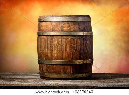 Wooden barrel on a yellow red background